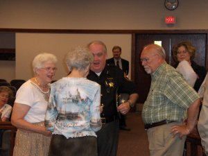 Retiring Victim's Advocates Roseann Martin and Barbe Limpert speaking with Ottawa County Sheriff Bob Bratton