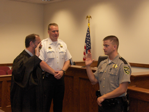 Officer Brandon Taylor being sworn in as a Danbury Township Police Officer by Judge Hany II.